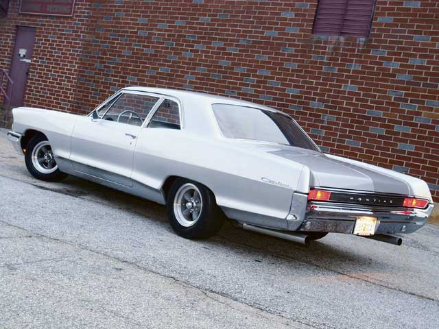When was last time you saw a post coupe '65 B-body? With all the trim, emblems, and ornaments removed, this Catalina looks ultra-clean. But its down and dirty potential is hinted at by the Mickey Thompson radials wrapped around American Torque Thrusts.