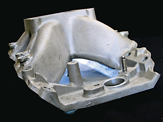 Race-style intake manifolds feature divorced runners, with a separate valley plate isolating the passages from the hot valley below. No exhaust crossover to be found here. Cooler air is denser, adding power, while lower temperatures reduce the tendency to detonate.