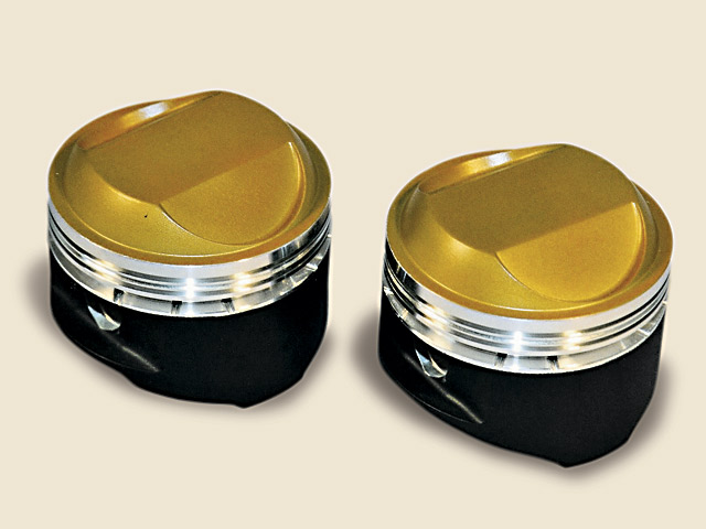 These Indy Cylinder Head Hemi pistons received a thermal barrier coating on the crown, and a friction-reducing coating on the skirt.  Thermal barrier coatings can improve power, since retaining heat in the combustion process means getting more efficiency from the charge in the cylinder.