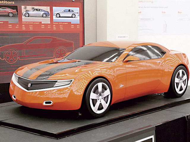 This early one-third scale model was rejected as being too rakish. We found the background more interesting: The board at left shows the Camaro's competitors as being the new Mustang, but surprisingly also the Infiniti G35 and BMW 330. Could this be a sign of future pricing? We hope not!
