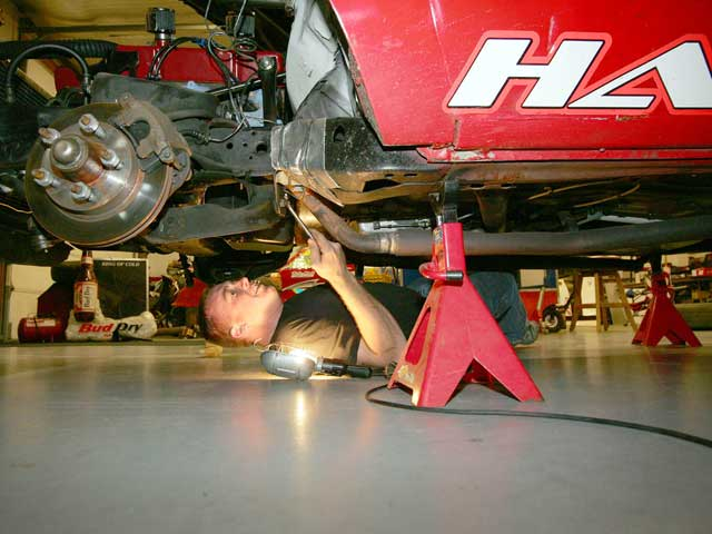 If you are doing a converter swap, you are going to be spending a lot of time under the car. Go ahead and raise the car on jackstands so you will have a comfortable place to work. It's safer, too.