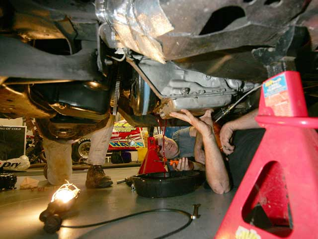 Before pulling the transmission, don't forget to drain the oil from the system or you could be in for a nasty surprise