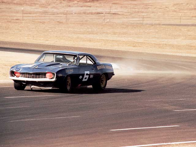 The '69 Trans Am season was hard-fought, as evidenced by the right front damage on Donohue's Camaro in this photo from Riverside. Still, Chevrolet again took the manufacturer's championship based on the Penske-Donohue effort.