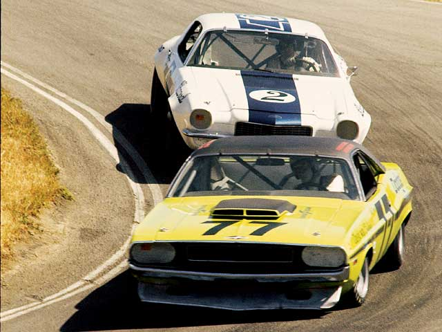 Rule changes allowed de-stroked engines down to the 5.0 liters for 1970-made cars like Sam Posey's #77 340ci Challenger or the 400ci Firebird Trans Am eligible for the series. The 'Cuda was sometimes fast (it took the pole at Bryar) but fragile.