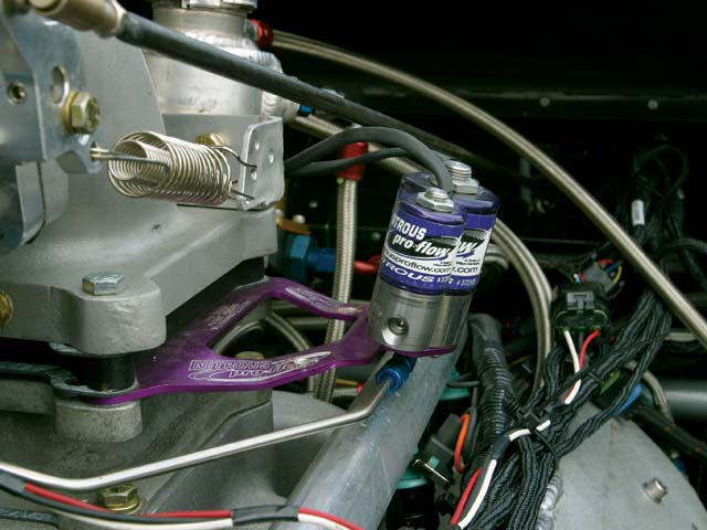A Wilson Manifolds Nitrous Pro Flow plate system with a 0.060-inch nitrous jet helps generate sufficient engine speed to get the massive turbos spinning fast enough to build boost on the starting line.
