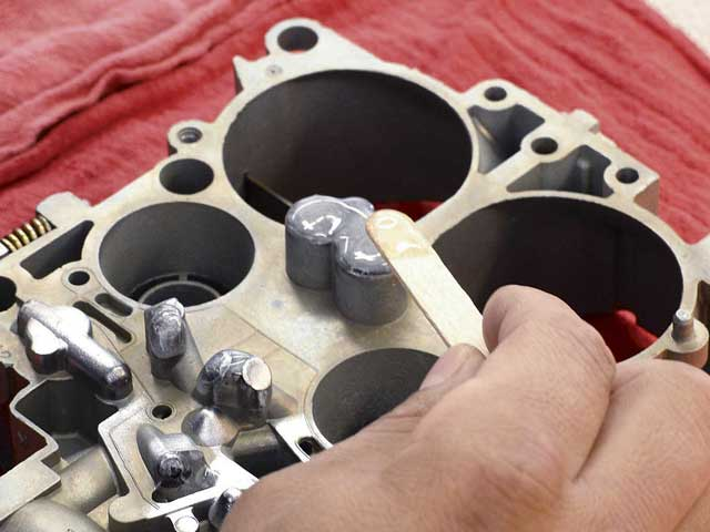 The well plugs are epoxied to ensure that no air leakage throws off the carb's ability to properly mix air and fuel.