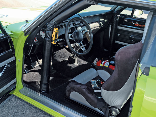 The interior is definitely all business: seats, a shifter, rollcage, and N.O.S. equipment. The name of the game in a road race is timing your arrival.
