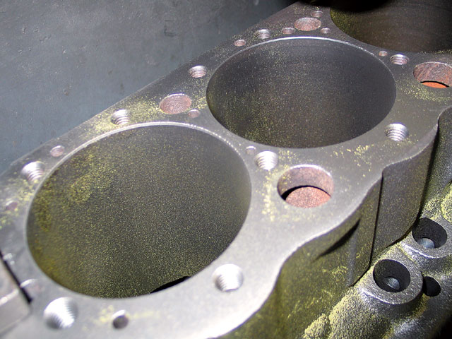 Dry Magnaflux is still the way machine shops look for cracks. A large U-shaped magnet is placed on the block, and it is dusted with magnetic powder. Cracks disrupt the field and attract the powder to the area. If a crack is found, a pressure test can be performed to evaluate its severity.