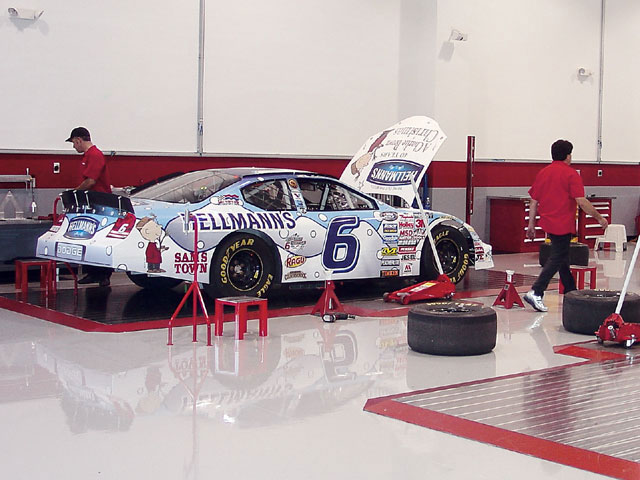 Mechanics at Evernham Motorsports go through the final setup on two Busch Series cars headed for a weekend event. In 2006, the team expects to run at least 10 driver-development races.