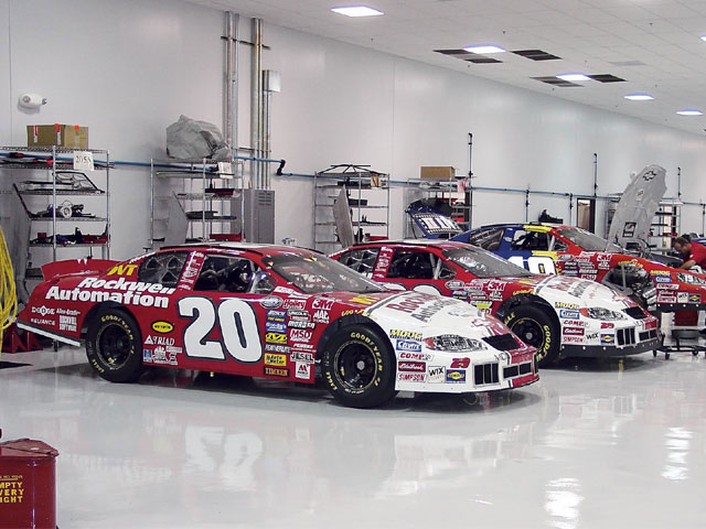 Denny Hamlin's Busch Series cars are lined up and awaiting service at the 100,000-square-foot Joe Gibbs Racing shop in Huntersville, North Carolina. The team runs its Busch, Hooters Pro Cup, and NASCAR Dodge Series driver-development teams out of the facility.