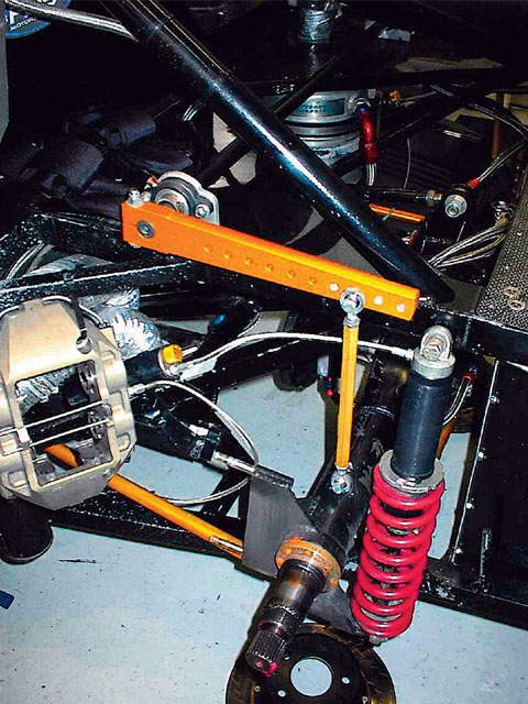 A typical rear sway bar installation uses a high mount and arms with several holes used to adjust the length of the arm, which changes the rate of the assembly. Note that the link between the sway bar arm and the rear end is 90 degrees off the arm and directly above and in line with the motion of the axle tube.