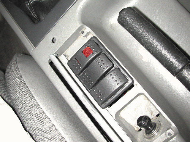 The three-button control panel features five separate functions. Pressing button A to the left activates the bottle heater, while pressing the button to the right arms the system. Button B is the momentary switch for the purge. Button C opens the bottle when pressed to the left and closes the bottle when pressed to the right. It's ergonomically friendly, extremely functional, and we especially like its inconspicuous design.