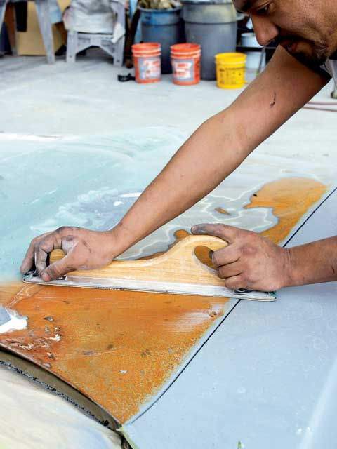 Not all rust treatments have to be expensive or chemically messy. If surface rust is the extent of your oxidation trouble, you can grind it off using a disc sander or long board and some 36-grit paper.