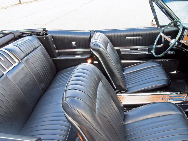The interior is luxurious and tastefully executed. A full-length lockable console separates deeply bolstered Strato bucket seats shod in leather. The rear speaker is artfully framed by a double-chrome faceplate with a Pontiac crest in the center separating the rear-seat passengers.