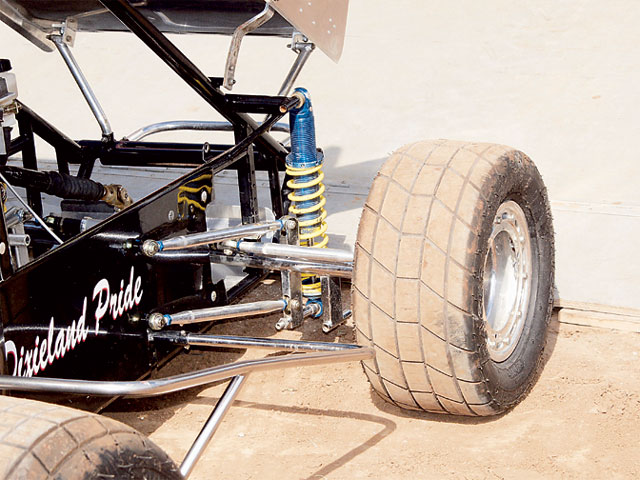 Notice how aero dirty the front of this Sprint Car is. The shock, axle, roll bars, brakes, and so on are hanging out in the wind. Rules may prevent some changes, but whatever we can do to clean up our cars in an aero sense would be worth it.