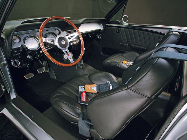 There's not a single original Ford piece used in the interior, but it retains a very classic Mustang feel. Most pieces, including the dash, are handformed aluminum.