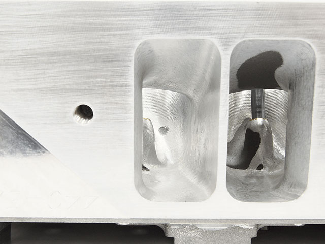 A view down the intake ports shows the result of the CNC porting. The intake runners have been opened up to Max Wedge size. Opening up the ports to this larger size really picks up the flow on these EZ heads. Porting with a CNC program ensures an even flow characteristic with all the cylinders.