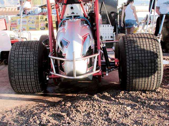 The difference in diameter from the right rear to the left rear shows the amount of stagger that is in this car to aid in getting it around the corner. Notice that only the left-rear tire on this Sprint car has additional grooving.