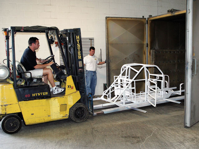 Powdercoating race car chassis is very popular because the coating is much tougher than traditional paint, but it is outside the scope of most race shops because it requires a large oven such as this one.