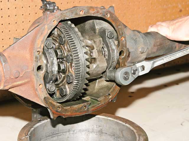 To remove the differential, a 5/8-inch socket and a 1/2-inch breaker bar was used to break each of the four bearing-cap bolts loose.