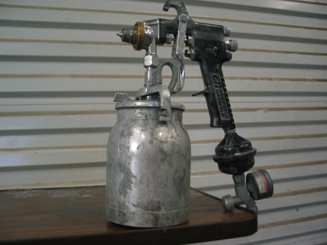 This is a can-style paint gun. While it is possible to apply a nice paint job with one of these paint guns, most professionals now use the more efficient HVLP paint guns.