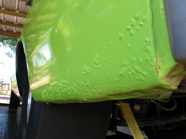 The most common cause of paint bubbles, like the ones shown on this Demon, is not removing or properly chemically treating the rust underneath before paint is applied.
