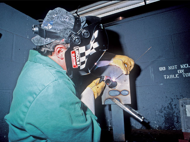 Welding chrome-moly tubing starts out easy, and you can make it as difficult as you want. Here, a student takes on a complicated welding position all on his own.