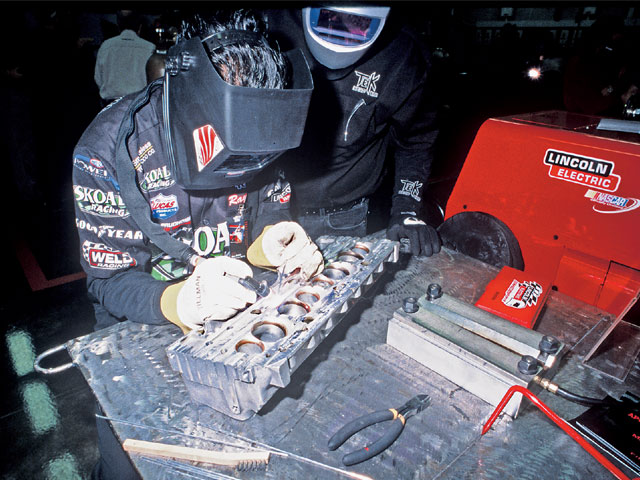 At Lincoln's advanced welding seminar, race teams from all kinds of motorsports are invited to try new equipment and methods of mostly TIG welding. Here, a crewmember from a pro drag team welds on a scrap aluminum head with a new Lincoln inverter TIG welder.