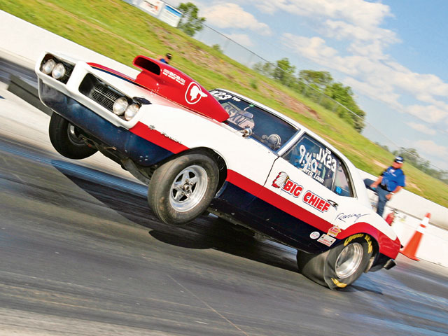 Jerry Loan and his '68 Firebird are fixtures at most Pontiac events in the eastern U.S., and he's a very tough competitor. Here, he lifts the front wheels in the heat of bracket action.