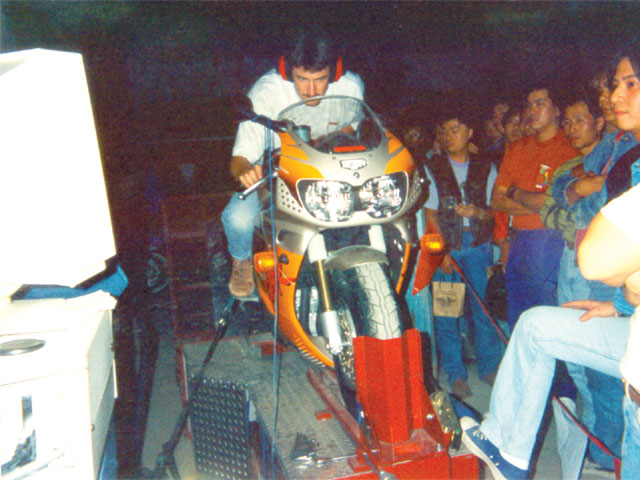 Demonstrating the Dynojet 100 bike dyno in communist China, Dobeck entertained these bikers in the hills above Macao.