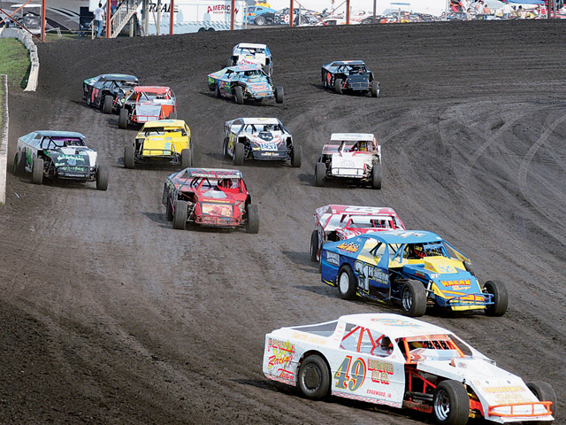 Wide-open races in wide-open spaces. The wide and well-prepared track surface at Boone (Iowa) Speedway allows the traditional three-wide starts and gives racers plenty of room to charge to the front.