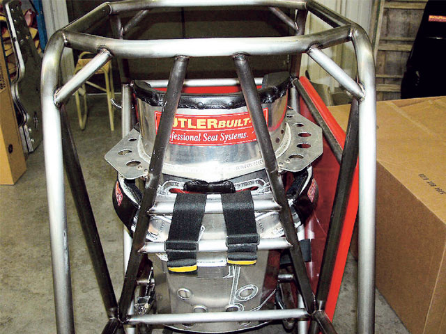 The seat must be mounted firmly to the rollcage structure. Here is a mock-up of a Sprint Car seat and the actual installation in a Sprint Car. The strong supports for the head and shoulders prevent lateral movement. Photo by Bob Bolles