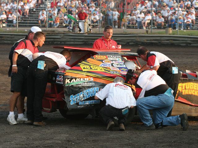IMCA inspections are serious business. Here, Garry Stube is getting the twice-over after qualifying for a main event at Boone Speedway.