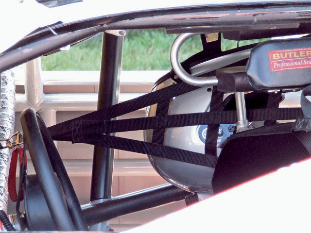 Head nets were first mounted in a stock car on the right side to control head movement from right-side lateral impacts.
