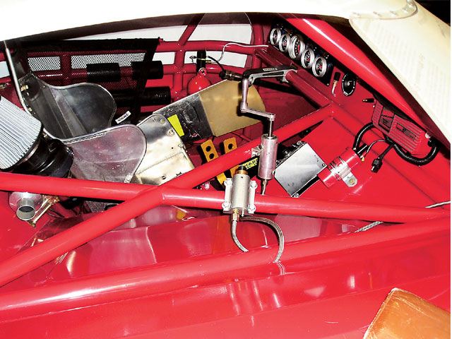 This Super Late Model cockpit has all of the adjusters, the MSD box, and the fire bottle securely bolted to the rollcage bars. If a modern seat was installed, the driver would be much safer. This driver was in a serious crash and sustained life-threatening neck injuries. A proper seat and a head-and-neck restraint might have helped.