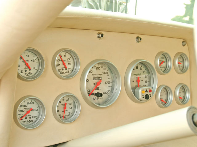 A full complement of Auto Meter Sport Comp gauges were mounted in a fabricated dash fascia.