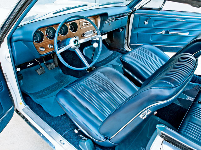 The interior is thought to be original except for the carpet, floor mats, and tissue dispenser. Though the GTOAA interior Judge felt that the door panels had been replaced, they have wear areas just above the armrests that could lead one to believe they are original, so the jury is still out on that one. Note the yellow rust-proofing plug in the door jamb. Points came off for all of these as well.