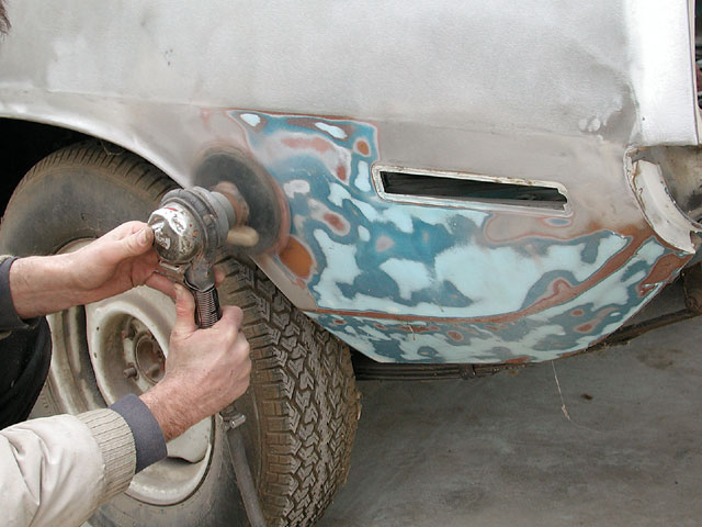 Sanding can knock the exterior of an entire car down to bare metal with one day's work. Orbital sanders, such as an air-operated D/A (dual-action) sander are preferred for automotive work, since such equipment minimizes trauma on the metal below.