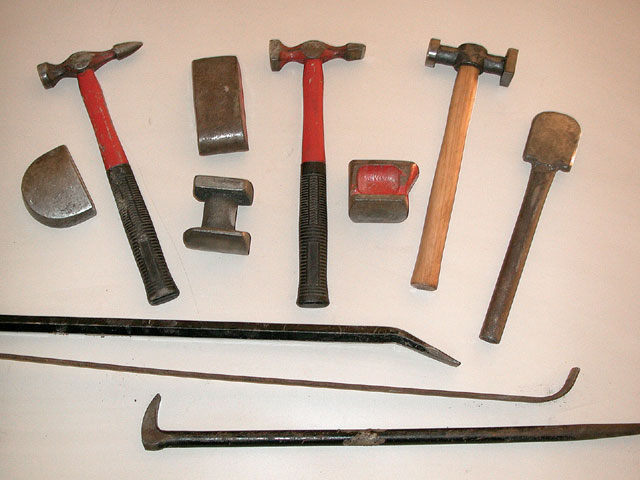 Metal working requires a variety of specialized, if somewhat crude, tools. Hammers, dollies, prybars, and slappers are all part of the rotation. In skilled hands, these can work wonders.