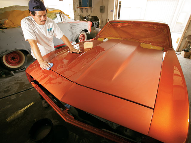 Even paint this nice can be improved by cutting and buffing for an absolutely stunning finish. The surface is carefully wet-sanded with very fine abrasive sandpaper and a backing pad.