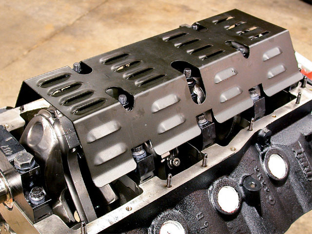 Bolting a windage tray over the main caps keeps flying oil from costing horsepower. This small-block Ford Moroso race-type oil pan is set up on a Dart block that's expected to see 8,000-rpm blasts.