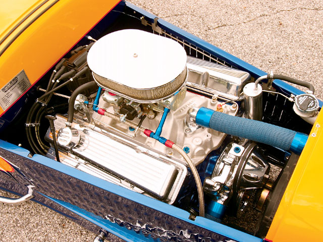 A 330-horse 350ci crate GM Performance Parts engine is used. We get both the go and the show under the hood with an Edelbrock intake and Barry Grant carburetor and Zoops dress-up parts.