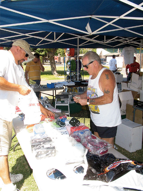Wheel guy Pete Paulsen has been selling at swaps for decades, and for his business, customers examine the sample new steel wheels and place orders, while the smaller custom items like taillights and chrome accessories are the fast sellers at the event.