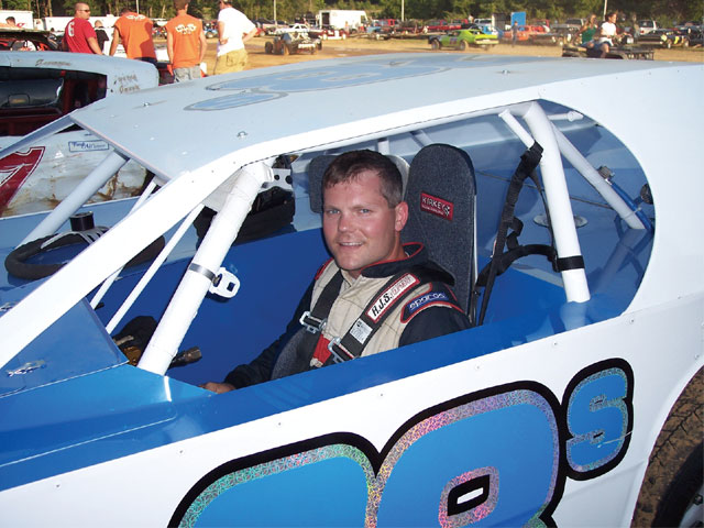 Chris Douglas prepares to race his dirt Modified car after running strictly on asphalt for over six years. The transition has been a smooth one; he is up to speed and running in the Top 5 after only 12 races.