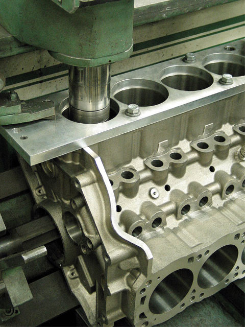 Believe it or not, the cylinder bores may not be correctly located from the foundry. This is because production-line tolerances aren't nearly what racers require. Using a B-H-J fixture when boring the cylinders helps center them over the crankshaft journals.