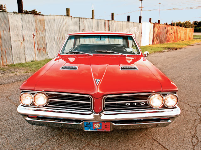 Documented by its original buildsheet, this GTO is a factory Tri-Power manual-trans car. Check out the '64 World's Fair plate.