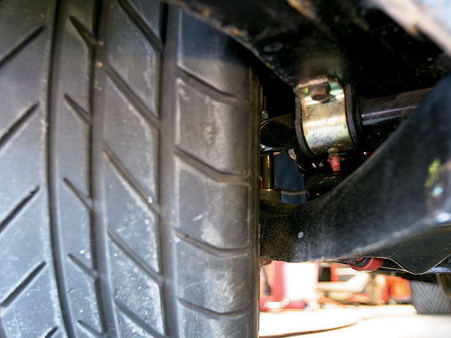 Here, this front tire-and-wheel package is too far inboard, contacting the sway bar long before the steering hits the stops. Always check clearance at ride height with the steering at full lock.
