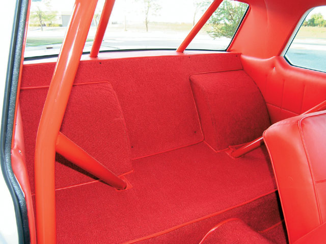 Taking the place of a rear bench seat, the massive wheeltubs are covered in matching red carpet, custom loomed to finish off the super-clean interior.