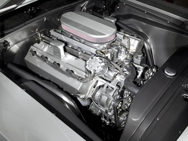 In addition to the firewall, all external engine parts were smoothed and painted. A stock-type dual-quad intake manifold was modified for the injectors and throttle-bodies.