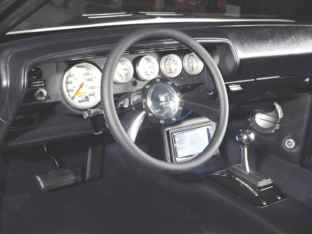Gear selection is made with a B&M QuickSilver shifter. A Kenwood head unit controls the mega-watt stereo.